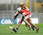 Darragh O Connell of Cuala in action against Niall Deasy of Ballyea during the All-Ireland Club Hurling Final at Croke Park. Photograph by John Kelly.