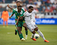 KANSAS CITY, KS - JUNE 26: Levi Garcia #11 and Daniel Kadell #3 battle for the ball during a game between Guyana and Trinidad
