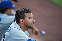 Ogden Raptors coach Angel Sanchez watches from the dugout during the game against the Orem Owlz in Pioneer League action at Home of the Owlz on June 20, 2015 in Provo, Utah. The Raptors defeated the Owlz 9-6.   (Stephen Smith/Four Seam Images)