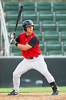 Collin Kuhn #13 of the Kannapolis Intimidators at bat against the Asheville Tourists at Fieldcrest Cannon Stadium on July 28, 2011 in Kannapolis, North Carolina.  The Intimidators defeated the Tourists 2-1 in 10 innings.   (Brian Westerholt / Four Seam Images)