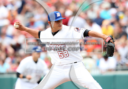 Buffalo Bisons Pitcher John Lujan (58) delivers a pitch during a game vs. the Syracuse Chiefs at Coca-Cola Field in Buffalo, New York;  June 3, 2010.  Syracuse defeated Buffalo 7-1.  Photo By Mike Janes/Four Seam Images