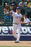 Round Rock Express third baseman Alex Buchholz (5) makes a throw to first base against the Colorado Springs Sky Sox in the Pacific Coast League baseball game on May 19, 2013 at the Dell Diamond in Round Rock, Texas. Colorado Springs defeated Round Rock 3-1 in 10 innings. (Andrew Woolley/Four Seam Images).