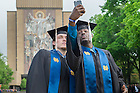 May 17, 2015; Former basketball team members Pat Connaughton, left, and Jerian Grant take a selfie in front of Hesburgh Library before the 2015 Commencement ceremony. (Photo by Matt Cashore/University of Notre Dame)