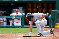 Adam Younger (8) of the Arkansas Travelers grimices in pain and takes a knee after having a foul ball hit his ankle during a game against the Springfield Cardinals on May 10, 2011 at Hammons Field in Springfield, Missouri.  Photo By David Welker/Four Seam Images.