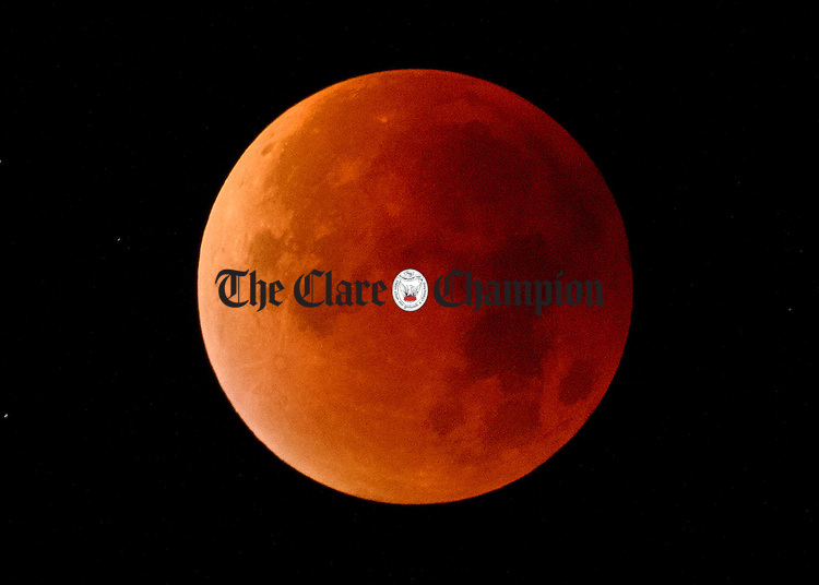 A view of the moon during the Lunar Eclipse early this morning. Photograph by John Kelly.