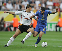 Italian midfielder (20) Simone Perrotta holds off German defender (5) Sebastian Kehl.  Italy defeated Germany, 2-0, in overtime in their FIFA World Cup semifinal match at FIFA World Cup Stadium in Dortmund, Germany, July 4, 2006.