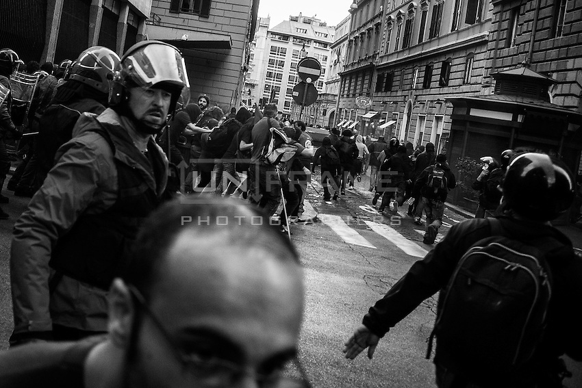 Riot Police hunts for escaping protesters after the entrance of the Ministry of Economy has been  attacked by a group of rioters, some of whom threw crude homemade explosive devices and others who took part in acts of vandalism. Rome, Italy. 09/10/2013