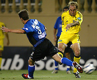 8 September 2004: Simon Elliott of Columbus Crew kicks the ball away from Richard Mulrooney of Earthquakes at Spartan Stadium in San Jose, California.  Crew defeated Earthquakes, 1-0.  Credit: Michael Pimentel / ISI