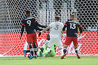 WASHINTON, DC - FEBRUARY 29: Washington, D.C. - February 29, 2020: Bill Hamid #24 of D.C. United defends the play against Drew Moor #3 of the Colorado Rapids. The Colorado Rapids defeated D.C. United 2-1 during their Major League Soccer (MLS)  match at Audi Field during a game between Colorado Rapids and D.C. United at Audi FIeld on February 29, 2020 in Washinton, DC.
