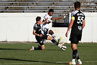 RICHMOND, VA - SEPTEMBER 30: Kenny Hot #76 of New York Red Bulls II tackles the ball away from Dre Fortune #8 of North Carolina FC during a game between North Carolina FC and New York Red Bulls II at City Stadium on September 30, 2020 in Richmond, Virginia.