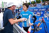 17 JUL 2011 - HAMBURG, GER - Barbara Riveros Diaz (CHI) talks with her coach Darren Smith before the start of the women's Hamburg round of triathlon's ITU World Championship Series .(PHOTO (C) NIGEL FARROW)