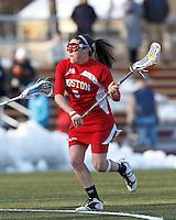 Boston University attacker Elizabeth Morse (5) on the attack. .Boston College (white) defeated Boston University (red), 12-9, on the Newton Campus Lacrosse Field at Boston College, on March 20, 2013.