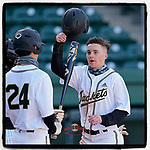 Brock Myers (5) of the Greer High School Yellow Jackets is greeted after scoring a run in a game against the T.L Hanna High School Yellow Jackets on Saturday, March 20, 2021, at Fluor Field at the West End in Greenville, South Carolina. Hanna won, 4-3. (Tom Priddy/Four Seam Images)