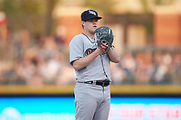 Scranton/Wilkes-Barre RailRiders starting pitcher Josh Rogers (13) looks to his catcher for the sign against the Charlotte Knights at BB&T BallPark on April 12, 2018 in Charlotte, North Carolina.  The RailRiders defeated the Knights 11-1.  (Brian Westerholt/Four Seam Images)