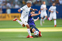 CARSON, CA - JUNE 19: Julian Araujo #2 of the Los Angeles Galaxy attempts to move past a sliding Shane O'Neill #27 of Seattle Sounders FC during a game between Seattle Sounders FC and Los Angeles Galaxy at Dignity Health Sports Park on June 19, 2021 in Carson, California.