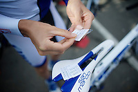 Lucas Euser (USA/United Healthcare) prepping a parcours-sticker for his top-tube<br /> <br /> 79th Flèche Wallonne 2015