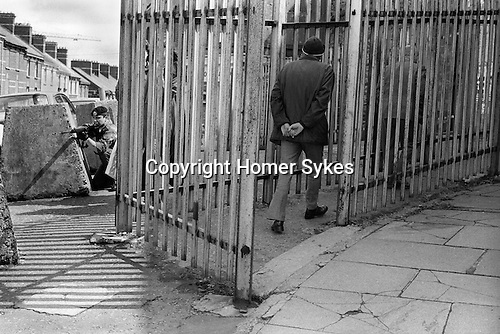 Derry Northern Ireland Londonderry. 1979. British soldiers on patrol at Butchers Gate,  a gateway through the old city wall and into the commercial centre of Derry. Londonderry Northern Ireland. 1970s UK