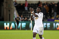 Pictured: Bafetimbi Gomis of Swansea thanks home supporters at the end of the game Saturday 10 January 2015<br /> Re: Barclays Premier League, Swansea City FC v West Ham United at the Liberty Stadium, south Wales, UK