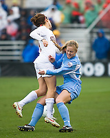 North Carolina defender Rachel Givan (16) and Stanford forward Kelley O'Hara (19) collide. North Carolina defeated Stanford 1-0 to win the 2009 NCAA Women's College Cup at the Aggie Soccer Stadium in College Station, TX on December 6, 2009.
