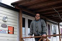 Terremoto del L'Aquila un' anno dopo. Earthquake L'Aquila one year after.Settimio Perilli allevatore di ovini e equini davanti la casa donata dalla FAI CISL.Settimio Perilli farmer of sheep and horses in front of the house of FAI CISL..