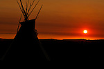 A teepee is silhouetted at sunrise in Fort Smith, Montana.