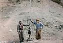 Iraq 1979. In Nawzang, on march 21st, on the right, Talat Guili, engineer, with the antenna of the new radio he set up for the PUK.<br /> Irak 1979. A Nawzang, le 21 mars, a droite Talat Gulli, ingénieur posant devant l'antenne de la nouvelle radio qu'il vient d'installer pour l'UPK.<br /> <br /> عیراق 1979 ، روژی 21 ی مارس، له لای راسته وه: ته له ت گویلی خه ریکی دانانی ئانتین بو رادیوی تازه ی داومه زراوی یه .کیتی یه<br /> Îraq 1979,  Li Nawzang, 21ê Adarê. Li alî rastê, muhendîs Talat Guili xwe dayê ber antênê radyoya nû ku wî ji boy YNK danandiyê.