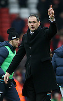 Swansea City manager Paul Clement celebrates by pointing to the sky after the final whistle of the Premier League match between Liverpool and Swansea City at Anfield, Liverpool, Merseyside, England, UK. Saturday 21 January 2017