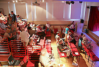 """Audience settling in for a performance by """"Pluck"""" body theatre with music, Leconfield Hall, Petworth Festival, West Sussex."""