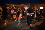 Tracer Harman dances to the live band Hired Gunz with his daughter Kali, 2, during the 20th Taste of Downtown, which is put on by the Advocates to End Domestic Violence, in Carson City, Nev., on Saturday June 15, 2013.<br /> (Photo by Kevin Clifford/Nevada Photo Source)