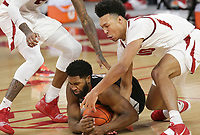 Arkansas forward Jaylin Williams (10) tries to retrieve a loose ball as Georgia Andrew Garcia (4) grabs a hold, Saturday, January 9, 2021 during the second half of a basketball game at Bud Walton Arena in Fayetteville. Check out nwaonline.com/210110Daily/ for today's photo gallery. <br /> (NWA Democrat-Gazette/Charlie Kaijo)