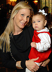 Debbie Chenevert with Emerson,1, at the Houston Symphony League's annual Magical Musical Morning event at the Houstonian Saturday Dec. 12,2009.(Dave Rossman/For the Chronicle)
