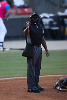 Home plate umpire Tre Jester makes a strike call during the game between the Delmarva Shorebirds and the Pescados de Carolina at Five County Stadium on September 4, 2021 in Zebulon, North Carolina. (Brian Westerholt/Four Seam Images)