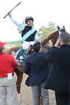 April 12, 2014:  Jockey Joe Bravo celebrates after winning the Arkansas Derby (Grade I) at Oaklawn Park in Hot Springs, AR. Zoie Clift/ESW/CSM