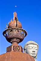 The moon appears over the Buddha statue and another piece at the Lahaina Jodo Mission, Maui.