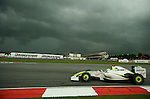 05 Apr 2009, Kuala Lumpur, Malaysia ---   Brawn GP Formula One Team driver Jenson Button of Great Britain steers his car in a cloudy sky during the 2009 Fia Formula One Malasyan Grand Prix at the Sepang circuit near Kuala Lumpur. Photo by Victor Fraile --- Image by © Victor Fraile / The Power of Sport Images