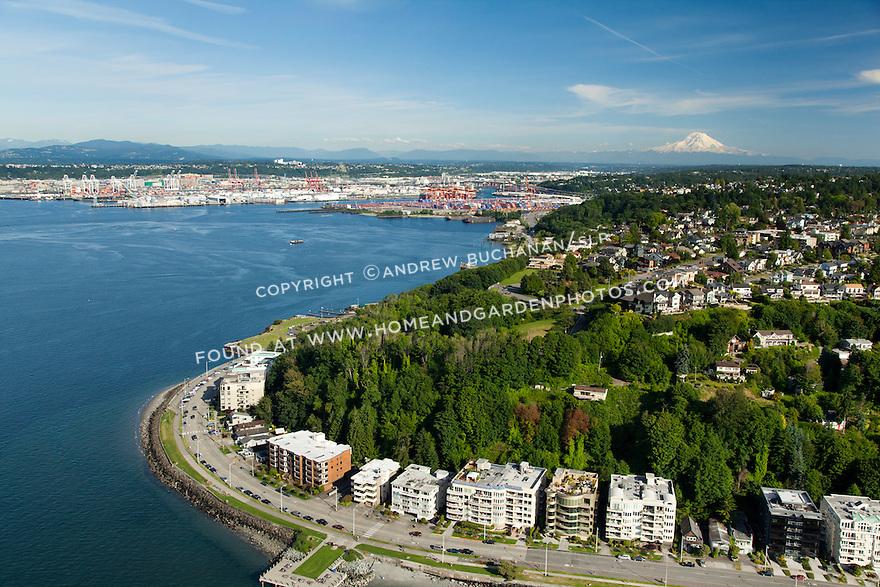 West Seattle shoreline on Elliott Bay with Mount Rainier glowing behind; Seattle, WA