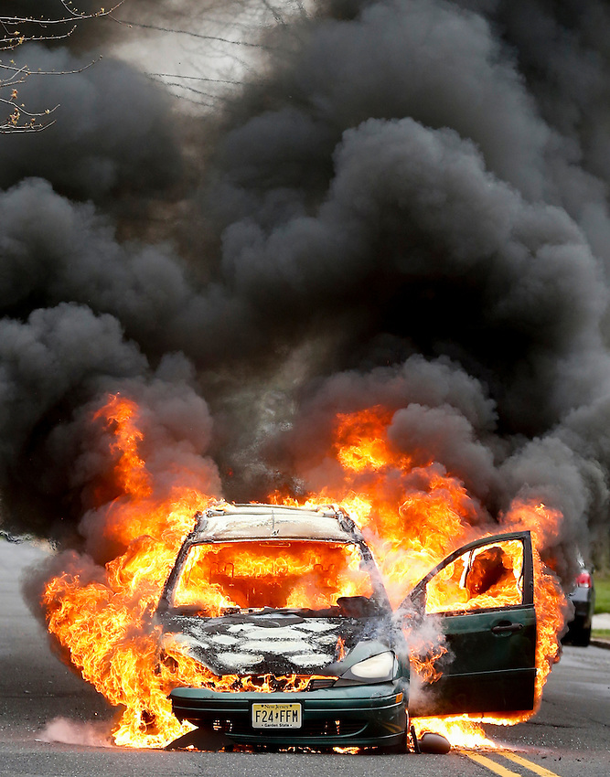 MANASQUAN, NJ — April 1, 2016 —A 2000 Ford Focus becomes fully engulfed in flames about 9:40am on Broad Street, here. The driver of the vehicle, Nancy Trapani of Belmar, was not injured.  photo by Andrew Mills