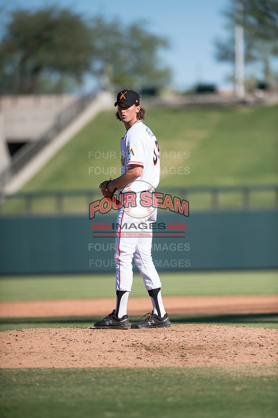 Salt River Rafters relief pitcher Tommy Eveld (33), of the Miami Marlins organization, gets ready to deliver a pitch during an Arizona Fall League game against the Glendale Desert Dogs at Salt River Fields at Talking Stick on October 31, 2018 in Scottsdale, Arizona. Glendale defeated Salt River 12-6 in extra innings. (Zachary Lucy/Four Seam Images)