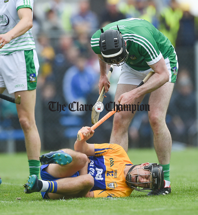David Reidy of Clare goes down injured as Declan Hannon of Limerick towers overhead during their Munster championship game in Ennis. Photograph by John Kelly.