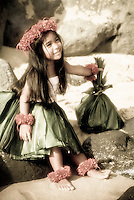 Keiki (child) hula dancer with ti leaf offering