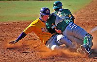 19 April 2009: University at Albany Great Danes' outfielder Brendan Rowland, a Junior from Albany, NY, slides home safely ahead of the attempted tag by University of Vermont Catamount catcher Mike McCarthy, a Freshman from Wallingford, CT, at Historic Centennial Field in Burlington, Vermont. The Great Danes defeated the Catamounts 9-4 in the second game of a double-header. Sadly, the Catamounts are playing their last season of baseball, as the program has been marked for elimination due to budgetary constraints on the University. Mandatory Photo Credit: Ed Wolfstein Photo