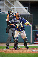 New Hampshire Fisher Cats catcher Wilkin Castillo (14) looks for a popup in front of umpire Mike Wiseman during a game against the Harrisburg Senators on June 2, 2016 at FNB Field in Harrisburg, Pennsylvania.  New Hampshire defeated Harrisburg 2-1.  (Mike Janes/Four Seam Images)