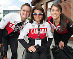 Calgary, AB - June 5 2014 - Colette Bourgonje poses for a photo with Women's National Hockey Team members Marie-Philip Poulin and Rebecca Johnston during the Celebration of Excellence Heroes Tour visit to Ronald McDonald House in Calgary. (Photo: Matthew Murnaghan/Canadian Paralympic Committee)