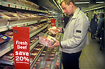British beef in supermarket London   <br /> Man checking prices North London 1990s UK.