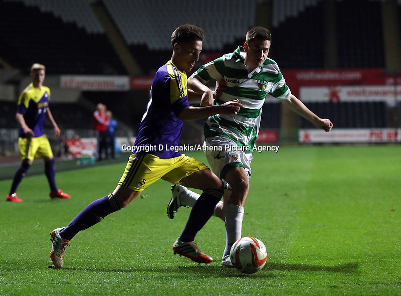Thursday, 16 April 2014<br /> Pictured L-R: Josh Sheehan of Swansea against a TNS player <br /> Re: FAW Youth Cup Final, Swansea City FC v The New Saints FC at the Liberty Stadium, south Wales,
