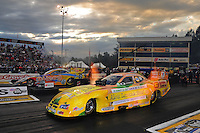 Sept. 30, 2011; Mohnton, PA, USA: NHRA funny car driver Johnny Gray (near) races alongside Jim Head during qualifying for the Auto Plus Nationals at Maple Grove Raceway. Mandatory Credit: Mark J. Rebilas-