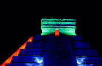 "Pyramid in colorfull spotlight at night. Chichen Itza - from Yucatec Maya: Chi'ch'èen Ìitsha ""at the mouth of the well of the Itza"") is a large pre-Columbian archaeological site built by the Maya civilization located in the northern center of the Yucatán Peninsula, in the Municipality of Tinúm, Yucatán state, present-day Mexico...Chichen Itza was a major focal point in the northern Maya lowlands from the Late Classic through the Terminal Classic and into the early portion of the Early Postclassic period. The site exhibits a multitude of architectural styles, from what is called ""In the Mexican Origin"" and reminiscent of styles seen in central Mexico to the Puuc style found among the Puuc Maya of the northern lowlands. The presence of central Mexican styles was once thought to have been representative of direct migration or even conquest from central Mexico, but most contemporary interpretations view the presence of these non-Maya styles more as the result of cultural diffusion. foto, reise, photograph, image, images, photo,<br />