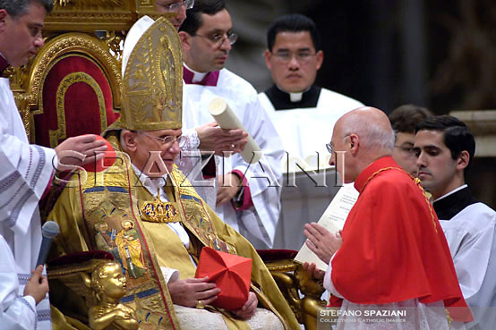 New cardinal Angelo Bagnasco of Italy receives the red biretta, a four-cornered red hat, from Pope Benedict XVI during the Consistory ceremony in Saint Peter's Basilica at the Vatican November 24, 2007. Pope Benedict, elevating 23 prelates from around the world to the elite rank of cardinal, made a pressing appeal on Saturday for an end to the war in Iraq and decried the plight of the country's Christian minority.