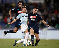 Calcio, Serie A: Roma, stadio Olimpico, 20 settembre 2017.<br /> Lazio's Ciro Immobile (l) in action with Napoli's Cristian Maggio (r) during the Italian Serie A football match between Lazio and Napoli at Rome's Olympic stadium, September 20, 2017.<br /> UPDATE IMAGES PRESS/Isabella Bonotto