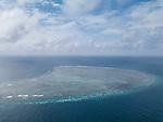 Hatta Island, Banda Sea, Indonesia; an aerial view of the massive submerged coral reef at Karang Hatta